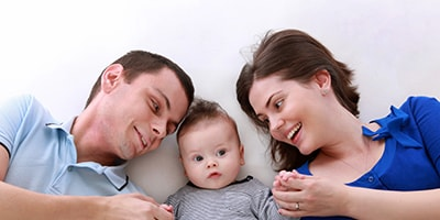 Photo of a happy family who enjoy Lux Dental visits in MA.
