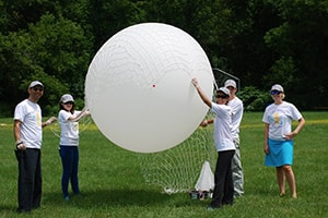 Lux dental team participating in a space balloon program